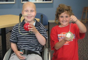 Skyler and Natalie showing their ornaments